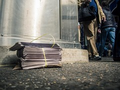 Newspaper Stack 42nd Street. (Jp Gary) Tags: nyc streets newspaper stack sidewalk worms m5 eyeview omd 14mm