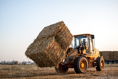 End of spring (Aviram Ostrovsky) Tags: sunset tractor israel spring jcb end hay stacks