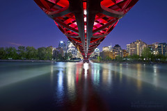 Peace Bridge - Night (Will Christensen) Tags: bridge red canada calgary water skyline river alberta bow calatrava peacebridge willchristensen