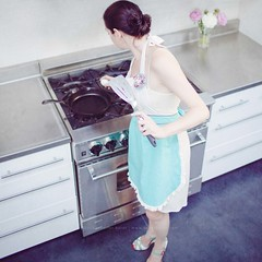 29 :: 31 (sweethardt) Tags: sanfrancisco flowers portrait woman selfportrait cooking kitchen female self fry stainlesssteel photographer counter egg cook lifestyle peony gas apron domestic stove bayarea castiron vase brunette anthropologie bluestar girlie spatula fryingpan burners peonies frilly frying sweethardtphotography ©2013jenniferhardt