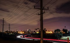 Telephone Lines and Power Lines (Crystal_rivera) Tags: city longexposure gloomy riverside cloudy powerlines freeway telephonelines riversideca citybynight purpleskys