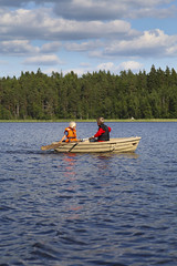 Rowing on lake (Anders Sellin) Tags: summer vacation lake water barn children fun sweden row adventure uppsala rowing sverige ro lifejacket semester dingy sommar tena sj rowingboat roddbt 2013 ventyr flytvst