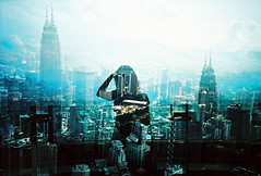 -urban lady (Hodaka Yamamoto) Tags: building silhouette lca lomography crossprocessed doubleexposure crossprocess double lomolca multipleexposure crossprocessing malaysia kualalumpur doubles multiexposure
