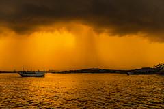 5-detik-sebelum-Hujan (M.Ilh4m) Tags: ocean sea orange sun reflection rain clouds landscape boat village background waterscape seaocean