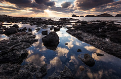 A tale of two landscapes (DMac 5D Mark II) Tags: light sunset sea seascape rock stone clouds reflections landscape stormy coastline rays southkorea jeju volcanic goldenhour lateafternoon intothesun basaltic