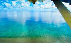Aerial view of a lagoon (ibrahimirshad) Tags: sea sky sun holiday ariel beautiful landscape photography top maldives drone guraidhoo kaafu kguraidhoo