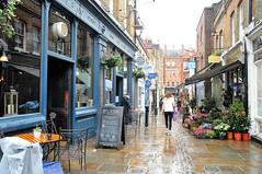 Flask Walk, Hampstead. NW3, London. UK (standhisround) Tags: uk flowers people london rain architecture buildings pub walk memories streetscene shops hampstead publichouse nw3 theflask flaskwalk