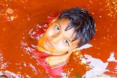 Red Baptism (Jakob Kolar) Tags: street travel boy red portrait orange india water colors face festival asia colours religion ceremony celebration hindu indien colorfestival mathura holifestival youngboy vrindavan uttarpradesh festivalofcolours huranga
