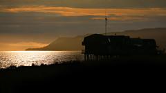 Homer spit (freakingrabbit) Tags: sunset shadow sea orange usa black alaska dusk spit homer coastline