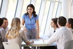 Businesswoman-leading-meeting-stock (sarahmepstein) Tags: professional businesswoman powerful meeting important colleagues coworkers board
