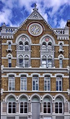 This is Abbots Court in Clerkenwell, one of my favourite building facades in London. It stands in Farringdon Lane and has a clock because, in 1875, it was built for John Greenwood & Sons who manufactured and imported clocks and watches. (juliavhill) Tags: england london clock architecture watch islington clerkenwell farringdon clockmaker watchmaker horology farringdonlane abbotscourt