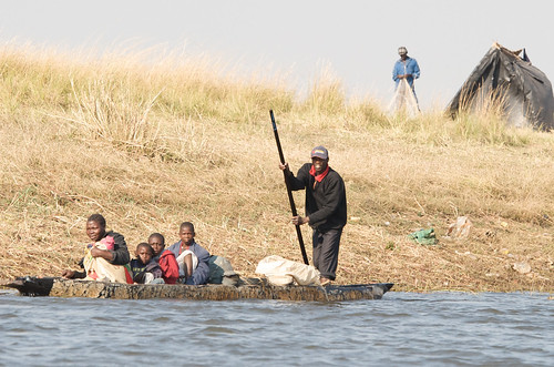 A family travelling in a canoe, Zambia. Photo by Patrick Dugan, 2012.