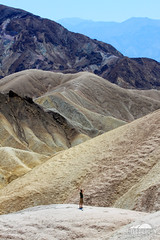 Zabriskie Point, Death Valley (Seth Berry Photography) Tags: california park mountains hot lines yellow rock stone point person death sand view desert dry human national valley deathvalley hiker peaks zabriskie zabriskiepoint formations sethberryphotography