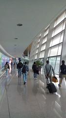 Kunming Changshui International Airport  (Mel@photo break) Tags: china light people motion colors airport folk terminal mel artsy international slowshutter passenger melinda kunming yunnan   changshui  chanmelmel melindachan  kunmingchangshuiinternationalairport