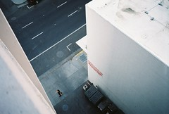 Walking woman (dannondale) Tags: california 35mmfilm sacramento nikonl35