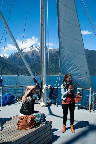 sea newzealand sky people snow mountains water clouds boat ship sails scene nz southisland fjord milfordsound tasmansea lanscape mitrepeak fiordlandnationalpark southwestnewzealandworldheritagearea milfordmarner milfordsoundnaturecruise