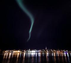 Aurora over Reykjavik city (Reykjavikphoto.com) Tags: longexposure winter sky cold green nature night canon stars landscape island eos star frozen iceland nightscape horizon tripod wideangle astro arctic aurora nightsky auroraborealis 6d northenlights