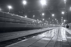 Train leaving Malm C (drougge) Tags: longexposure bw train lensflare rails nightphoto tg meyeroptikgrlitzlydith30mmf35 rls rawtherapee malmc canon5dmarkii