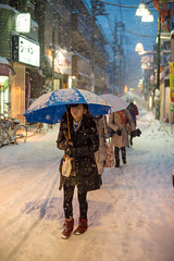 Trudging Through Tokyo Snow (aeschylus18917) Tags: road street winter woman snow girl japan night umbrella 50mm tokyo pedestrians   snowfall  danielruyle aeschylus18917 danruyle druyle