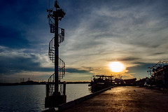 Sunset on Muara Angke (Irwin Day) Tags: sunset harbor siluet muara karang angke