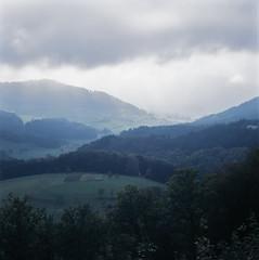 (xbacksteinx) Tags: sun fall 120 film clouds analog mediumformat germany landscape october mood moody slide 100mm fujifilm e6 blackforest provia100f lightrays planar expiredfilm hasselblad500cm rdpiii zeiss100mmf35