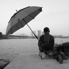 Han Umbrella Fisherman (Lig Ynnek) Tags: city bridge blackandwhite umbrella fisherman seoul southkorea hanriver