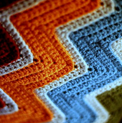 cosy stripes (Winter Ghosts) Tags: orange green wool purple turquoise stripes crochet cream chevron zigzag multi doublecrochet doubleknitting macromondays