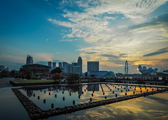 Urban Sunrise (elenaleong) Tags: skyline architecture sunrise reflections singapore cityscape cloudy marinabay