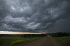 Bearing down (Len Langevin) Tags: sky canada storm weather clouds landscape nikon alberta thunderstorm nikkor thunder gravelroad d300 18300