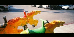 Horses are loose! (jfpj) Tags: california panorama horse film fuji ride toycamera sanjose panoramic plastic shoppingcenter plasticcamera coinoperated trashcam plasticlens pixpanorama fuji400film fakepanoramic kidsride