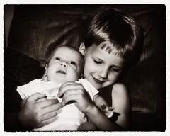 Brother (Oliver Leveritt) Tags: 35mm film blackandwhite monochrome sepia platinum children boys baby infant candid konicafs1 sunpakflash