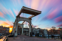 Skinny bridge sunset (l3v1k) Tags: city travel bridge sunset urban holland heritage tourism monument netherlands beautiful dutch amsterdam clouds sunrise river skinny canal europe long exposure vibrant sightseeing culture destination brug hdr amstel magere 500px ifttt amazingtravelshots