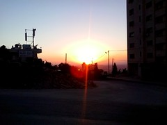 "It's all about ""Running Away"". (farida_kilani) Tags: sunset red yellow orange sun going runningaway running escaping nablus palestine home dark night sky color colors land bird line light tree mount building end fire fine purple"
