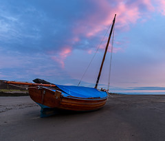 The sky was pink (SiKenyonImages) Tags: pink blue sunset sky beach boat sand waterfront curve wirral merseyside meols