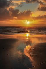 Low tide (zebedee1971) Tags: light sunset orange sun reflection waves waikato raglan