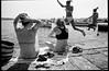 (Summer Madness) (Robbie McIntosh) Tags: leicamp leica mp rangefinder streetphotography 35mm film pellicola analog analogue negative leicam analogico blackandwhite bw biancoenero bn monochrome argentique dyi selfdeveloped filmisnotdead autaut candid strangers leicaelmarit28mmf28iii elmarit28mmf28iii elmarit 28mm arsimagofd arsimagofddeveloper arsimagofd159 seaside rocks fujineopanacros fuji neopan acros dive cannonball girls women
