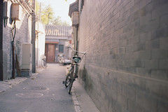 Against The Wall (a l e x . k) Tags: film bicycle pentax beijing lx fa43mmf19