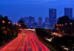Evening Rush (Rebecca Ang) Tags: city blue light red urban architecture highway singapore apartments cityscape lighttrails bluehour hdb thebluehour cte urbanarchitecture centralexpressway eveningrushhour housinganddevelopmentboard rebeccaang