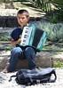 Beggar (Stephen Whittaker) Tags: nikon child beggar accordian d5100 whitto27