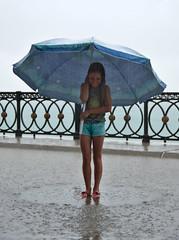Princess Of Rain (BlaizeG) Tags: sea beach girl rain umbrella shower kid parasol rainfall
