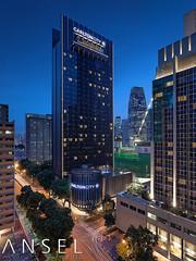 Carlton City (draken413o) Tags: city travel blue skyline architecture night digital singapore long exposure carlton skyscrapers hour hotels blending destinations