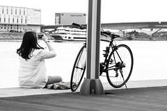 Hanging out at the docks (donandsuji) Tags: bw woman bicycle