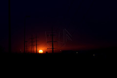 The Sun Sets (QueeN CooL) Tags: city blue pakistan sunset red orange sun mountains nature colors beautiful yellow clouds buildings purple setting islamabad