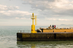 Yellow lighthouse (Mauro Taraborelli) Tags: winter sea italy lighthouse yellow statue harbor europe mediterranean afternoon watching marche senigallia adriatic ancona monteconero nikond7000