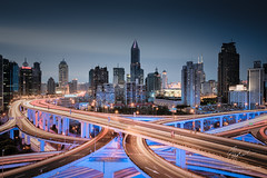 Neon Metropoles (Lord Shen) Tags: skyline architecture traffic rushhour elevated