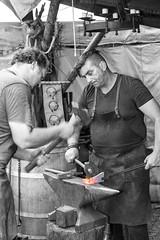 """Strike while the iron is hot."" (Harald Schnitzler) Tags: hot feldkirch iron medieval heat strike blacksmith eisen colorkey mittelalter schmieden schmied"