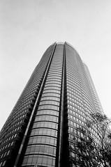 Moon (Yosh the Fishhead) Tags: bw building film monochrome japan architecture skyscraper tokyo blackwhite films 28mm lookingup lookup ricoh gr1 foma fomapan100 fomapan ricohgr1 grlens