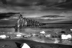 defenders of the realm (explored) (I AM JAMIE KING) Tags: sea seascape nature landscape ir coast mood atmosphere erosion infrared weathered peninsula groynes eastyorkshire enviroment spurnpoint seadefences defendersoftherealm