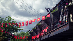 Dragons and flags (elizunseelie) Tags: trees red sky west building crimson architecture photoshop scarlet asian star restaurant scotland iron vietnamese dragon wind pentax cloudy glasgow balcony flag scottish dragons stormy flags end express waving railings k5 lightroom snapseed