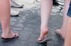Girl tough soles in flip fllops (Face11) Tags: girls girl female skin flip barefoot heels flops rough tough soles dangle callous calloused